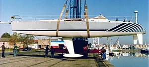 Naval architecture - The hull of a racing yacht being lifted from the water for maintenance