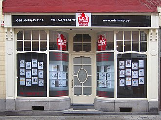 Estate agent - Front windows of a little estate agency Mons (Belgium).