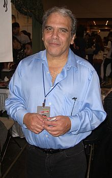 Valentino standing at a convention
