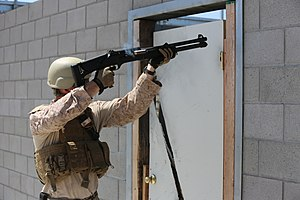 Breaching round - A US Marine  practices shotgun door-breaching techniques