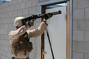 Breaching round - A US Marine  practices shotgun door-breaching techniques