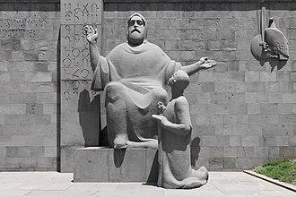 World Teachers' Day - Mesrop Mashtots teaching Yeghishe the Armenian alphabet, a statue in Yerevan.