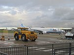2017-12-15 Aircraft tug and Flybe aircraft, Norwich Airport.JPG