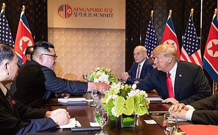 U.S. President Donald Trump and North Korean Leader Kim Jong-un during the 2018 North Korea-United States summit in Singapore, June 2018 2018 North Korea-United States summit - Kim and Trump shake hands.jpg