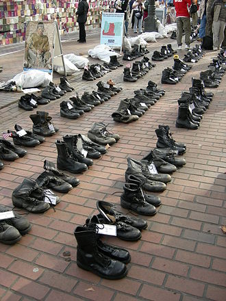 Opposition to the Iraq War - Combat boots arrayed in memory of the U.S. military war dead as part of an anti-war demonstration (Seattle, 2007).