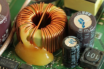 Toroidal inductor in the power supply of a wireless router 3Com OfficeConnect ADSL Wireless 11g Firewall Router 2012-10-28-0869.jpg