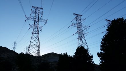 500 kV Three-phase electric power Transmission Lines at Grand Coulee Dam; four circuits are shown; two additional circuits are obscured by trees on the right; the entire 7079 MW generation capacity of the dam is accommodated by these six circuits. 500kV 3-Phase Transmission Lines.png