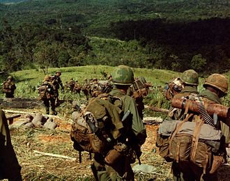 8th Infantry Regiment (United States) - Members of Co. C, 1st Bn, 8th Inf, 1st Bde, 4th Inf Div, descend the side of Hill 742, located five miles northwest of Dak To. 14–17 November 1967.