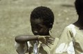 ASC Leiden - F. van der Kraaij Collection - 01 - 006 - Saye Town. An elementary school girl wearing earrings - Monrovia, Sinkor, Montserrado County, Liberia, 1976.tiff