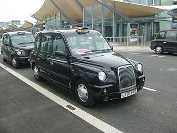 English: A TX4 Taxi at London Heathrow Airport...