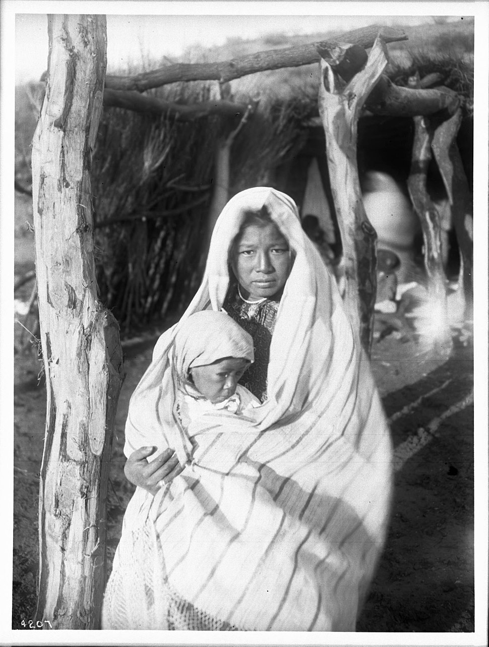 A Yaqui Indian mother holding a baby, Arizona, ca.1910 (CHS-4207)