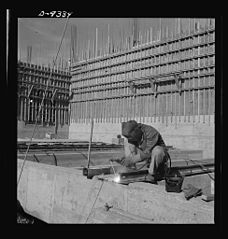 A helmeted welder is busily engaged in his part of the war effort 8b08232v.jpg