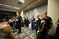 A member of the presidential inaugural committee, center, gives a brief on the sequence of events during the Commander in Chief's Ball at the Washington Convention Center in Washington, D.C 130121-A-TT930-021.jpg