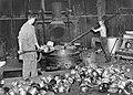 A selection of aluminium pots and kettles are put into the smelter at a workshop somewhere in Britain during a salvage drive in 1940. D734.jpg