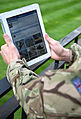 A serviceman accesses social media channels using an iPad, outside MOD Main Building in London MOD 45156042.jpg
