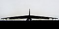 A silhouetted B-52H Stratofortress taxis down the runway (29777709056).jpg