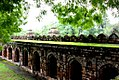A wall of the Lodhi Garden Monument on a rainy day.jpg