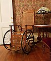 A wicker and wood wheelchair.jpg