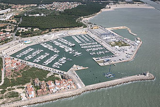 Marina - Aerial view of a typical marina (harbor dredge and lighthouse in lower right)