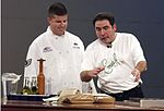 Air Force chef with celebrity chef Emeril Lagasse.jpg