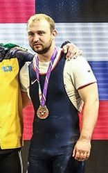 Aleksandr Ivanov in the third place of 2016 Fajr Cup in the men's 94 kg category.jpg