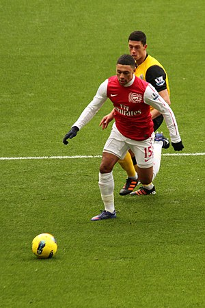 Jason Lowe - Lowe (yellow shirt, rear of picture) challenging Arsenal's Alex Oxlade-Chamberlain in 2012