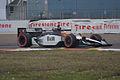 Alex Tagliani rounding Turn1 Morning Practice SPGP 28March2010 (14513079717).jpg