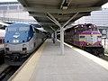 Amtrak 162 and MBTA 1127 at North Station, September 2006.jpg