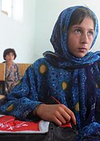 An Afghan girl and student of the newly opened Shar-e Sara Girls School waits for an eye examination from a coalition forces' ophthalmologist in Zabul province, Afghanistan, Sept 110913-N-AT856-025.jpg