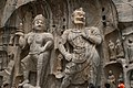 Ancient Buddhist Grottoes at Longmen- Fengxian Temple, Heavenly King & Celestial Guardian.jpg