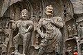 Ancient Buddhist Grottoes at Longmen- Fengxian Temple, Heavenly King & Celestial Guardian.jpg