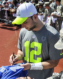 Andrew Luck signing autographs at 2014 Pro Bowl.jpg
