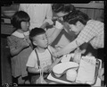 Arcadia, California. Evacuees of Japanese ancestry are vaccinated by fellow evacuees. - NARA - 537424.tif