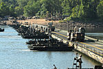 Army Convoy crosses bridge during training exercise.jpg