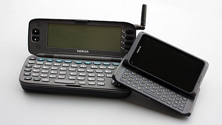 A Nokia 9000 Communicator (1996) next to a Nokia E7 Communicator (2011) As Time Goes By (Nokia 9000 Communicator & E7).jpg