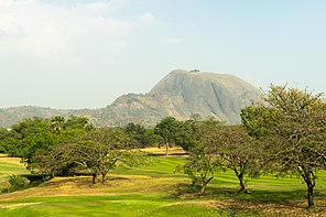 Aso Rock as seen from the IBB golf course in Abuja, Nigeria.jpg