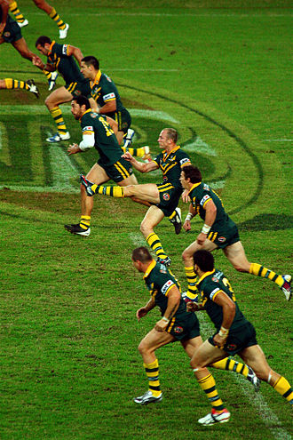 Rugby league gameplay - Players chase the ball after a kick-off. They must be behind or in line with the kicker when his foot hits the ball.