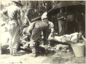 31st/51st Battalion (Australia) - Australian casualties being treated at the 31st/51st Battalion regimental aid post, following the fighting on Tsimba Ridge, 6 February 1945