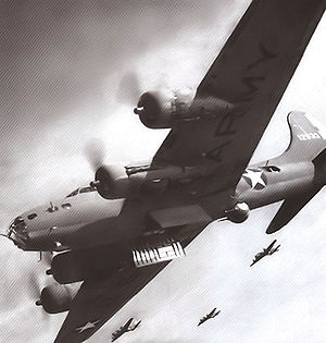 30th Bombardment Squadron - B-17s of the 19th Bombardment Group attacking Japanese-held Lae Airfield, New Guinea on 26–27 June 1942. Boeing B-17E Fortress 41-2633 (Sally) in Foreground.