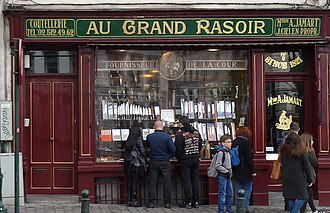 Monarchy of Belgium - Au grand Rasoir, a Royal warrant holder with Royal crest.