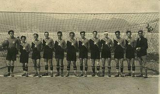 KF Vllaznia Shkodër - From left to right: Kin Bushati (goalkeeper), Ernest Halepiani, Gjelosh Gjeka, Pjeter Gjoka, Qazim Dervishi (captain), Muhamet Halili, Asim Golemi, Luigj Radoja, Gjon Kiri, Myzafer Pipa, Hile Staka, Luigj Shala (coach)