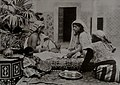 Berber women and a child on a patio, Tunis.jpg