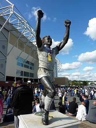 Billy Bremner - Billy Bremner statue in celebratory stance outside Leeds United's ground Elland Road