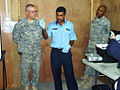 Bob Wirkner, left, watches as Iraqi police warrant officer Akram demonstrates how to take a DNA sample during an evidence-gathering practical exercise at Joint Security Station Deason, Iraq, July 6, 2011 110706-A-CY741-286.jpg