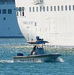 Brevard County Sheriff's boat next to Carnival Victory cruise ship in Port Canaveral, Florida.jpg