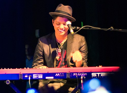 Bruno Mars is known for his stage performances, retro showmanship, and for performing in a wide range of musical styles, including R&B, funk, pop, soul, reggae, hip hop, and rock. Bruno Mars keyboard.jpg
