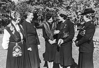 Sección Femenina - Pilar Primo de Rivera (second from right) at an international meeting of women in Nazi Germany, 1941.