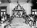 COLLECTIE TROPENMUSEUM Plechtigheden bij de kroning van de Sultan van Deli in 1925 op de troon de sultan en zijn echtgenote met aan weerszijden de rijkssieraden TMnr 10001572.jpg