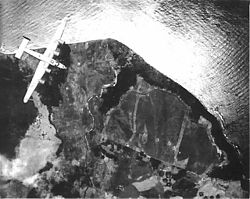 Cape Gloucester airdrome during pre-invasion bombing.jpg