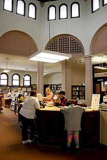 Librarians and patrons in a typical larger urban public library.